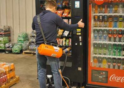 Using Airsled's adjustable spacers to move a vending machine on high legs