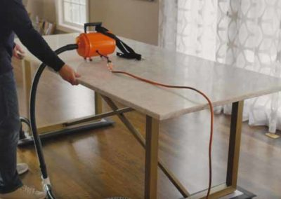 Moving heavy furniture over wood flooring with an Airsled