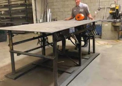 Moving a heavy welding table with an Airsled