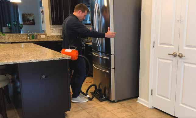 Moving a large refrigerator with an Airsled