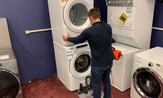 Safely move stacked laundry equipment with an Airsled