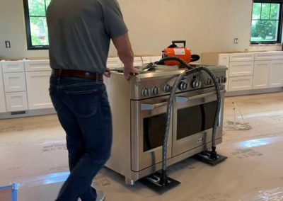 How to Move a GE Monogram Range with Airsled's Spacer Kit for Appliances on Legs