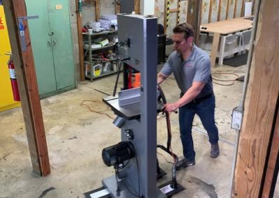 Airsled Light-Duty Appliance Mover Moving a Band Saw