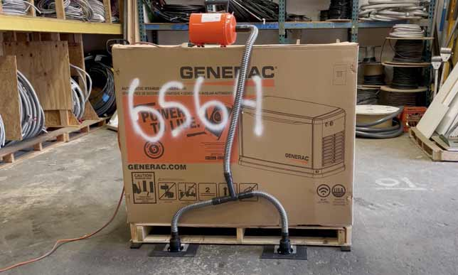 Airsled being used to lift a Generac generator sitting on a pallet
